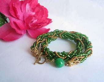 A bracelet,  stylish accessory. Fashionable green. Adornment on hand