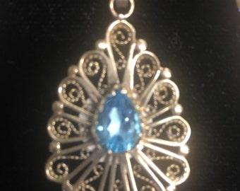 Intricate Pendant blue topaz stone