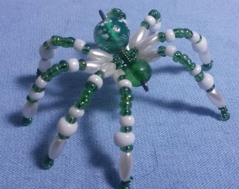 Green and white speckled beaded spider