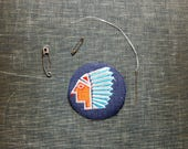 1970s vintage patch of a Native American chief in headdress . embroidered denim iron on patch