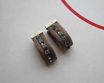 1970s vintage clip on earrings, gold mesh & light blue rhinestones, signed Sarah Coventry costume jewelry . ice blue glass wrap around mesh