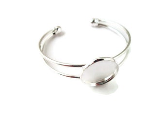 one cuff bracelet with a 20mm bezel setting, silver plated