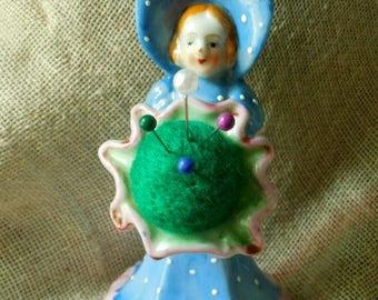 Vintage Sweet little Girl wearing Bonnet Carrying Flower Pin Cushion