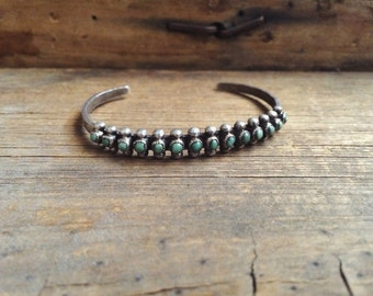Vintage green turquoise cuff, 14 stone Zuni snake eye row bracelet, Old Pawn turquoise bracelet, 1950s Native American stacking bracelet