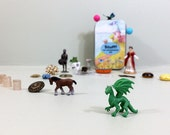 Child's treasure box with new and vintage tiny toys for imagination and fantasy play. Travel toys, busy box.