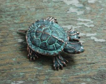 Small copper patina turtle