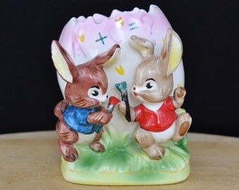 Vintage Bank with Bunnies Painting and Decorating an Egg