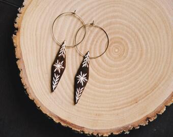 carved bone gypsy hoop earrings.