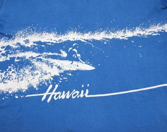 vintage 1980's -Crazy Shirts- Unisex T- shirt. 'Hawaii' with surfer shredding a wave - Front & back. All Cotton. Small - Medium