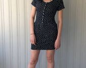 vintage black and white Polka Dot cotton stretch 1980s mini dress with snaps and decorative stitching.
