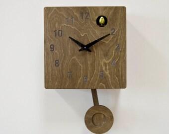 Tudor Oak Cuckoo Clock  with moving pendulum