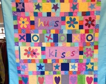 Hugs and Kisses machine appliqued quilt