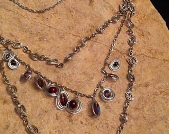 Silver Spiral Links Triple Strand Bib Necklace