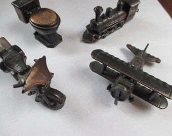 choice of 4 Vintage cast metal pencil sharpeners biplane train motorcycle commode toilet