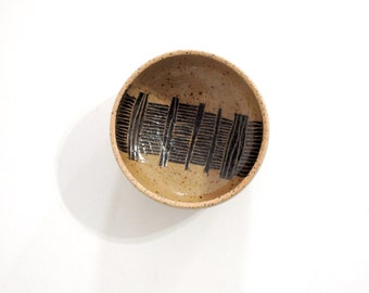 Black and tan striped stoneware bowl