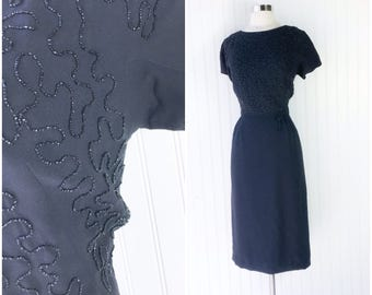 vtg 50s black crepe rayon jet beaded cocktail midi dress / Henry Lee / pinup party dress / squiggle bead pattern / short cap sleeves / bow