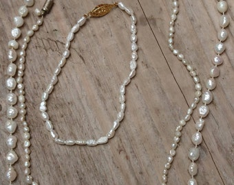 Two vintage rice Pearl necklaces and one bracelet