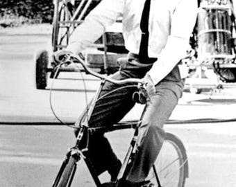 John F. Kennedy, Riding bike on a Hollywood set while campaigning in 1960.
