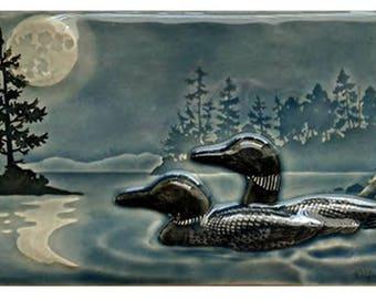 Ceramic sculpture, Moonlight Swim, 2017 version, Loon pair,