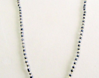 Long Cross necklace with single strand black and silver beads