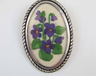 Vintage embroidered brooch, oval with purple flowers.