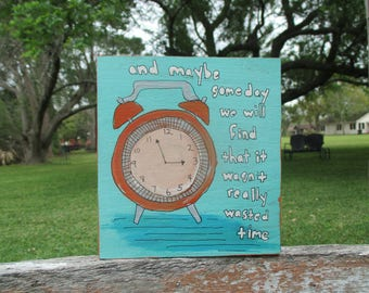the eagles inspired lyrics painting, wasted time lyrics, clock painting, folk art of salvaged wood, cute clock art, orange turquoise