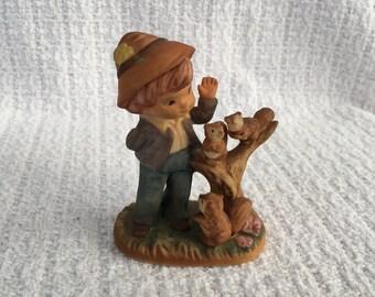 Boy with Squirrels Figurine, Boy Feeding Squirrels Figurine, M R Porcelain Figurine, #9980,  Squirrels,  Marks & Rosenfeld Importer
