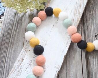 Garland of felted wool balls