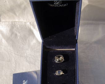 Vintage set of 3 SWAROVSKI rings complete with box and certificate.  SIZE 6