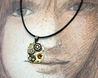 Steampunk  pendant : Gustav Klimt Style, pieces of watch & alarmclock, gears, black polymer resin, Swarovsi cabs on a black leather strap