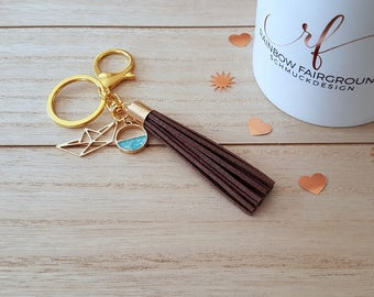 Key ring/ring origami boat, with 3 supporters of brown/gold