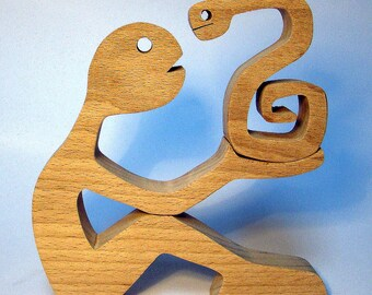 """sculpture wood scalloped """"some guy with a snake"""""""
