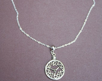 Silver-plated Clock necklace.