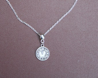 """Silver-plated clock necklace with 8"""" chain."""