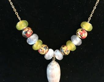 """handmade 18"""" Gold plated necklace with an Olive shell Pendant."""