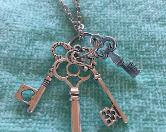 custom lovely silver alloy  chain with a ring of variety of shapes and sizes of keys matches anything