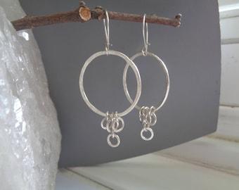 Sterling silver dangling hoops earrings