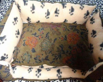 A Bespoke handmade Luxury Nest style Pet bed.  Made with soft fleece and vintage cord fabrics. Filled with soft stuffing, for comfort.