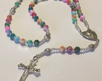 Pastel Watercolors and Silver Rosary in Easter Colors