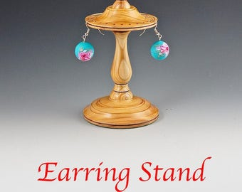 Earring stand in yew wood.