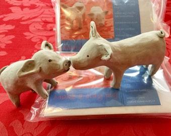 Make a clay pig kit.