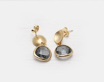 Beautiful gold-filled stud earring a grey glass stone.