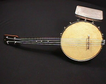 Vintage Banjo - Ukulele in Great Ready to Play Condition with New Strings Tuners,Bridge, and Tailpiece with a Real Skin Top