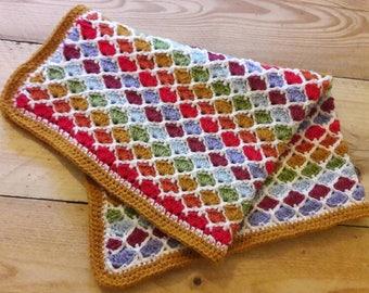 Colourful, handmade, rainbow crochet blanket