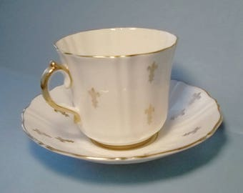 Fleur de lis tea cup and saucer - white and gold by Old Royal Bone Chin a of England