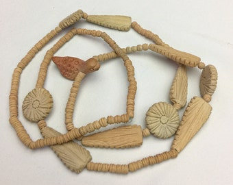 Terra-cotta clay beaded necklace with flowers, feathers and a cute little bird - flower child - organic