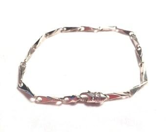 10k white gold CAL bracelet