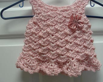 Handmade crochet baby girl dress in pink with pink flower as application made in baby soft yarn. Size 3-6 month.