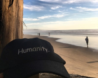 Humanity Cap (adjustable black hat with white text)