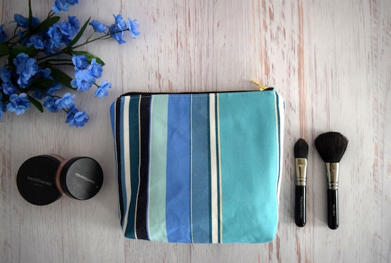 Blue Striped Makeup Pouch Made with Upcycled Fabrics. Recycled Zipper Close Bag in Blue and Cream. Flat Bottom Eco Friendly Pouch.